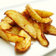 Stock Photo: Spicy baked potato wedges