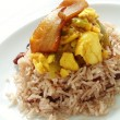 Stock Photo: Saltfish with ackee and jollof rice