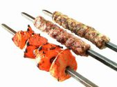 Kofta shish and tikka kebabs on white — Stock Photo