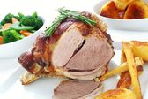 Roast leg of lamb with vegetables — Stock Photo