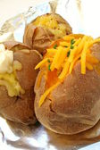 Selection of filled baked potatoes — Stock Photo