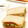 Tuna and sweetcorn sandwich on sliced brown bread — Stock Photo