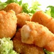 Breaded scampi tails with salad leaves — Stock Photo
