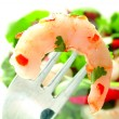 Large prawn on fork with salad — Stock Photo