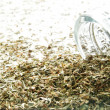 Dried sage spilling from glass jar — Stock Photo