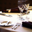 Place setting at laid restaurant banquet table — Stock Photo