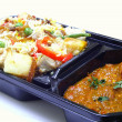 Authentic biryani in takeaway tray — Stok fotoğraf