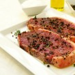 Sirloin steaks with olive oil pepper corns and thyme — Stock Photo