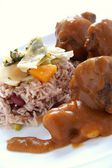 Caribbean style curried Oxtail served with rice mixed with red kidney beans — Stock Photo