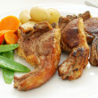 Grilled lamb chops with vegetables — Stock Photo