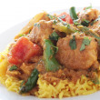 Stockfoto: Indian Chicken Jalfrezi curry with pilau rice