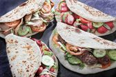Tikka kofte shish donner naan sandwiches — Stock Photo