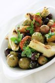 Mixed antipasti olives and artichoke — Stock Photo