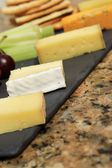 Cheese selection platter cheese board — Stock Photo