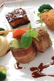 Plated pork selection dinner — Stock Photo