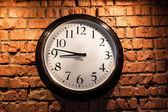 Clock on a brick wall — Stock Photo