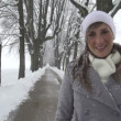 Smiling woman in winter avenue — Stock Video