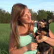 Girl with her dog in nature — Stock Video #32113397