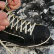 Stock Video: Lacing ice skates