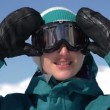 Snowboarder girl puts on ski goggles — Stock Video