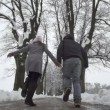 Couple running through winter promenade — Stock Video #32118445