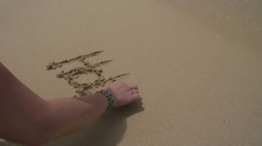 Word holiday written in sand — Vídeo de Stock