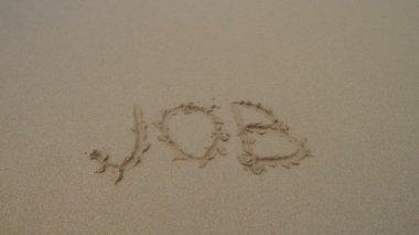 Word job written in sand — Stock Video
