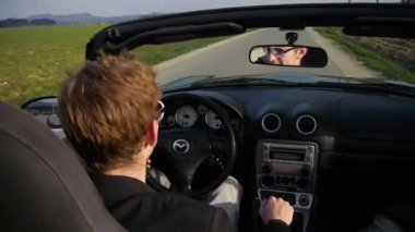 Young businessman driving — Wideo stockowe