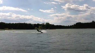 Wakeboarder performing a trick — Stock Video