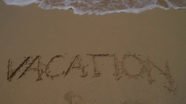 Word vacation written in sand — Stok video