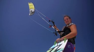 Young female kiteboarder — Stock Video