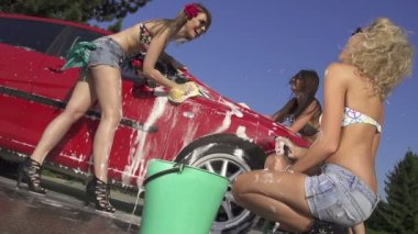 Gorgeous young women washing car — Stock Video