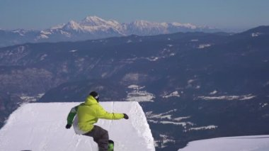 Snowboarder jumps powder kicker — Stock Video
