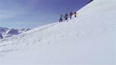 Skiers hiking uphill — Stock Video