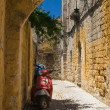 Moped parked outside the wall — Stock Photo #32734729