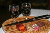 Sausage and wine - — Stock Photo