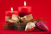 Red candle with xmas tree — Stock Photo