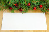 Christmas border with red berries and toys — Stock Photo