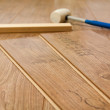 Laminate floor and tools used — Stock Photo #36355547
