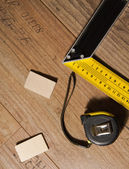 Laminate floor and tools used — Stock Photo
