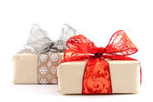 Box with red and silver ribbon — Stock Photo