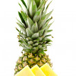 Half pineapple and slices on a white background — Stock Photo
