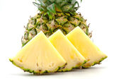 Half pineapple and slices on a white background — Foto Stock