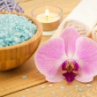 Spa Treatment with pink flower, towels and sea salt — Stock Photo