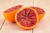 Ripe red blood oranges and slices  — Stock Photo