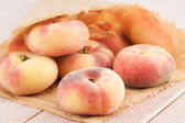 Ripe juicy chinese flat peaches  — Stock Photo
