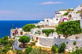 Mediterranean village with white houses on the sea — Stock Photo