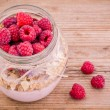 Breakfast: cereal with raspberries and yogurt — Stock Photo #49485115