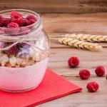 Breakfast: cereal with raspberries and yogurt — Stock Photo #49485341