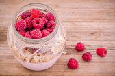 Breakfast: cereal with raspberries and yogurt — Stock Photo